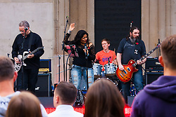 Covent Garden, London, October 30th 2014. They Royal British Legion's Poppy Day in London centred around Covent Garden where bands, choirs, classical and pop musicians entertained crowds as Air Force personnel carrying donation buckets sold poppies, hoping to raise in excess of £1 million. Pictured: Rock band Mixtape Nation performs for the crowds in Covent Garden.