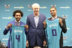 June 22, 2018 - Charlotte, NC, USA - Charlotte Hornets Devonte' Graham, left, and Miles Bridges, right, hold up their jerseys with President of Basketball Operations & General Manager Mitch Kupchak during an introductory news conference at Spectrum Center in Charlotte, N.C., on Friday, June 22, 2018. (Credit Image: © David T. Foster Iii/TNS via ZUMA Wire)