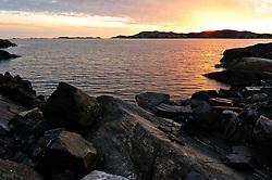 Sunset over the tiny island of Astols. Photo: Chris Davies/WMRT