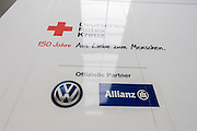 Deutsches Rotes Kreuz - DRK (German Red Cross) vehicle logos at their logistics centre at Berlin-Schönefeld airport.