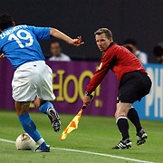 English Assistant Referee Philip Sharp watches Italy's Gianluca Zambrotta