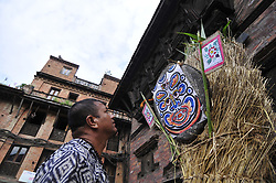 July 21, 2017 - Bhaktapur, NP, Nepal - Nepalese devotees making straw effigy demon Ghantakarna during the Gathemangal festival celebrated at Bhaktapur, Nepal on Friday, July 21, 2017. Gathemangal is a festival celebrating the defeat of the mythical demon Ghantakarna. (Credit Image: © Narayan Maharjan/Pacific Press via ZUMA Wire)