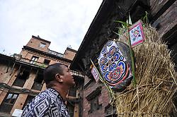 July 21, 2017 - Bhaktapur, NP, Nepal - Nepalese devotees making straw effigy demon Ghantakarna during the Gathemangal festival celebrated at Bhaktapur, Nepal on Friday, July 21, 2017. Gathemangal is a festival celebrating the defeat of the mythical demon Ghantakarna. (Credit Image: © Narayan Maharjan/Pacific Press via ZUMA Wire)