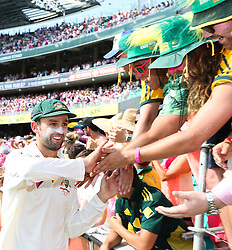 © Licensed to London News Pictures. 05/01/2014. Nathan Lyon shakes hands with spectators during celebration lap  during day 3 of the 5th Ashes Test Match between Australia Vs England at the SCG on 5 January, 2013 in Melbourne, Australia. Photo credit : Asanka Brendon Ratnayake/LNP