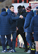 Exeter City manager, Matt Taylor and Stevenage manager Alex Revell fist bump after the final whistle during the EFL Sky Bet League 2 match between Exeter City and Stevenage at St James' Park, Exeter, England on 23 January 2021.