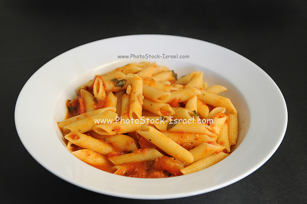 A serving of Penne pasta with tomato sauce