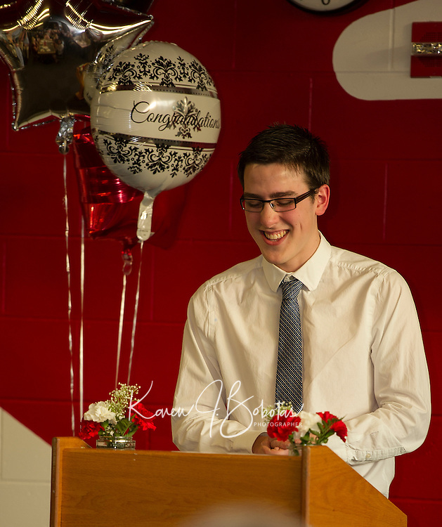 Michael O'Brien honored his music teacher Ms. Debbie Gibson during the LHS Top Ten senior dinner held at the Huot Center Tuesday evening.  (Karen Bobotas/for the Laconia Daily Sun)