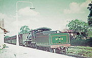 Steam train number 26 and passenger carriages at railway station platform, Arima, Trinidad early 1960s