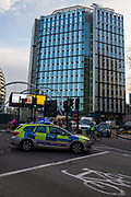 A police car stopping traffic at Old Street roundabout, London, United Kingdom.