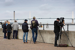 © Licensed to London News Pictures. 08/10/2019. Dartford, UK. People gather at Greenhithe in Kent to look for a humpback whale last seen in the Thames near the Dartford River Crossing Bridge yesterday. The humpback was seen at a few locations near the Dartford River Crossing over the weekend. Photo credit: Peter Macdiarmid/LNP