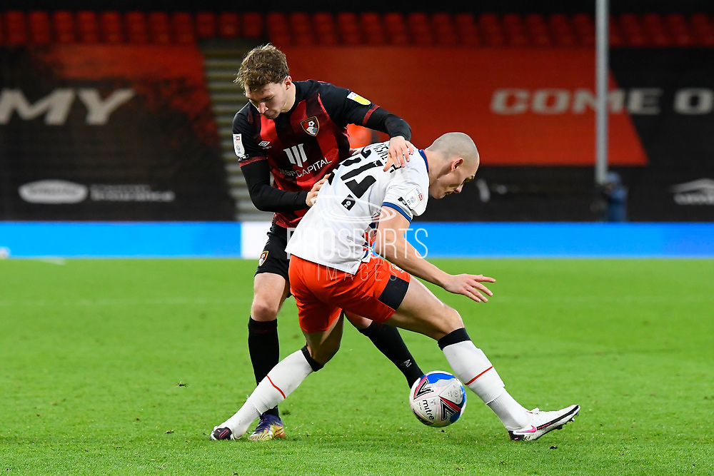 Jack Stacey (17) of AFC Bournemouth battles for possession with Kai Naismith (24) of Luton Town during the EFL Sky Bet Championship match between Bournemouth and Luton Town at the Vitality Stadium, Bournemouth, England on 16 January 2021.
