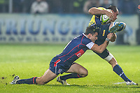 Mike Petri (L) of USA tries to stop Daniel Carpo (R) of Romania  during their  rugby test match between Romania and USA, on National Stadium Arc de Triomphe in Bucharest, November 8, 2014.  Romania lose the match against USA, final score 17-27.