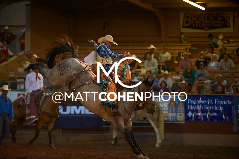 Saddle bronc rider Ty Kirkland of Lufkin, TX rides Night Stalker at the Pikes Peak or Bust Rodeo in Colorado Springs, CO.<br /> <br /> <br /> UNEDITED LOW-RES PREVIEW<br /> <br /> <br /> File shown may be an unedited low resolution version used as a proof only. All prints are 100% guaranteed for quality. Sizes 8x10+ come with a version for personal social media. I am currently not selling downloads for commercial/brand use.