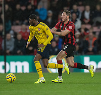 Bournemouth's Dan Gosling (left) vies for possession with Arsenal's Ainsley Maitland-Niles (right) <br /> <br /> Photographer David Horton/CameraSport<br /> <br /> The Premier League - Bournemouth v Arsenal - Thursday 26th December 2019 - Vitality Stadium - Bournemouth<br /> <br /> World Copyright © 2019 CameraSport. All rights reserved. 43 Linden Ave. Countesthorpe. Leicester. England. LE8 5PG - Tel: +44 (0) 116 277 4147 - admin@camerasport.com - www.camerasport.com