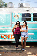 Sisters and owners of Veracruz, Maritz and Reyna Vazquez, stand at their school bus converted kitchen at the Webberville/East Side location.
