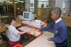 Secondary school pupil borrowing book from library,