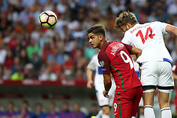 August 31, 2017 - Porto, Portugal - Portugal's forward Andre Silva heads the ball with Faroe Islands' defender Rogvi Baldvinsson during the 2018 FIFA World Cup qualifying football match between Portugal and Faroe Islands at the Bessa XXI stadium in Porto, Portugal on August 31, 2017. (Credit Image: © Pedro Fiuza/NurPhoto via ZUMA Press)