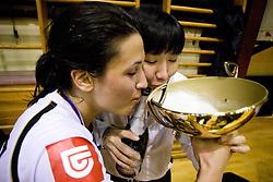 Andrea Lekic of Krim and Ljudmila Bodnjeva drinking champagne from cup at last 10th Round handball match of Slovenian Women National Championships between RK Krim Mercator and RK Olimpija, on May 15, 2010, in Galjevica, Ljubljana, Slovenia. Olimpija defeated Krim 39-36, but Krim became Slovenian National Champion. (Photo by Vid Ponikvar / Sportida)