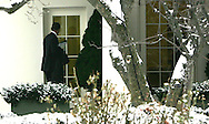 President Barak Obama mistakes a window for the door of the Oval Office after returning to the White House after meeting with House and Senate  Republicans on January 27, 2009.  photo by Dennis Brack