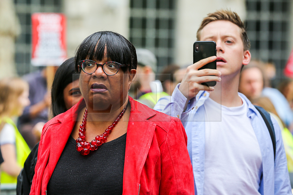 "© Licensed to London News Pictures. 07/09/2019. London, UK. Diane Abbott MP for Hackney North and Stoke Newington (L) and Owen Jones (R) during the rally ""Defend our Democracy and Stop Brexit"" in Whitehall, Westminster. The protesters are demonstrating against the British Prime Minister Boris Johnson's intention to prorogue Parliament until 14 October. Photo credit: Dinendra Haria/LNP"