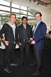 Left to right, F1 driver NARAIN KARTHIKEYAN, F1 driver DANI CLOS and LUIS PEREZ-SALA principal of the Formula One team HRT F1 at the F1 Party in aid of Great Ormond Street Hospital Children's Charity held at Battersea Evolution, Battersea Park, London on 4th July 2012.