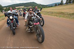 Aaron Green and Brad Gregory on Aidan's Ride to raise money for the Aiden Jack Seeger nonprofit foundation to help raise awareness and find a cure for ALD (Adrenoleukodystrophy) during the annual Sturgis Black Hills Motorcycle Rally. Riding the cut-off Fort Meade Way between I-90 and the Buffalo Chip, SD, USA. Tuesday August 8, 2017. Photography ©2017 Michael Lichter.