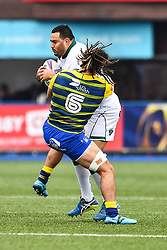 Pau's Malik Hamadache is tackled by Cardiff Blues' Josh Navidi<br /> <br /> Photographer Craig Thomas/Replay Images<br /> <br /> European Rugby Challenge Cup Round Semi final - Cardiff Blues v Pau - Saturday 21st April 2018 - Cardiff Arms Park - Cardiff<br /> <br /> World Copyright © Replay Images . All rights reserved. info@replayimages.co.uk - http://replayimages.co.uk