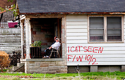 16 Jan, 2006. New Orleans, Louisiana. Post Katrina.<br />  An elderly couple, recently moved back to their home in the flooded Marigny neighbourhood sit out on their porch.<br /> Photo; Charlie Varley/varleypix.com