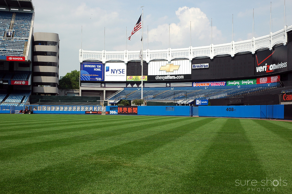 Original Yankee Stadium outfield as seen from the infield.  Monument Park is visible behind the left field wall. This picture was taken during the last year the Yankees played in this famous stadium.