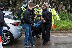 Hertfordshire Police officers arrest an anti-HS2 activist after invoking Section 14 of the Public Order Act 1986 to clear an area outside an entrance to the Chiltern Tunnel South Portal site for the HS2 high-speed rail link on 9 October 2020 in West Hyde, United Kingdom. A protest action by anti-HS2 activists, at the site from which HS2 Ltd intends to drill a 10-mile tunnel through the Chilterns, was intended to remind Prime Minister Boris Johnson that he committed to remove deforestation from supply chains and to provide legal protection for 30% of UK land for biodiversity by 2030 at the first UN Summit on Biodiversity on 30th September.