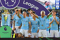 BRIGHTON, ENGLAND - MAY 12:   The Manchester City players celebrating on the podium with their winners medals before the Premer League trophy is lifted during the Premier League match between Brighton & Hove Albion and Manchester City at American Express Community Stadium on May 12, 2019 in Brighton, United Kingdom. (MB Media)