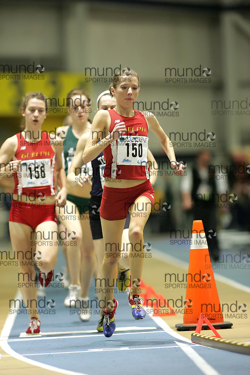(Windsor, Ontario---12 March 2010) Rachel Cliff of University of Guelph Gryphons   competes in the 3000m final at the 2010 Canadian Interuniversity Sport Track and Field Championships at the St. Denis Center. Photograph copyright Sean Burges/Mundo Sport Images. www.mundosportimages.com