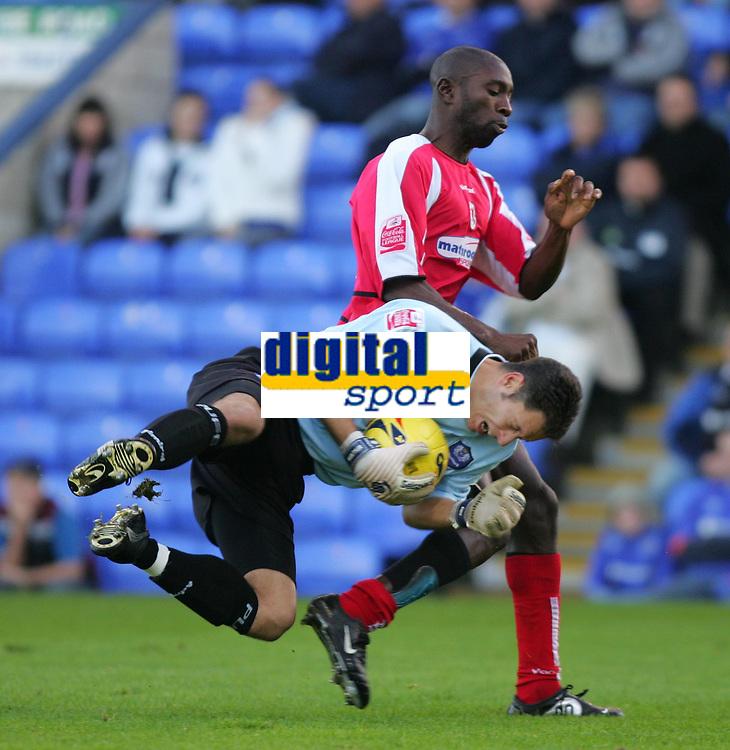 Photo: Frances Leader.<br />Peterborough Utd v Leyton Orient. Coca Cola League 2.<br />12/11/2005.<br />Orients Jabo Ibehre (L) colides with Borough's goalie Mark Tyler
