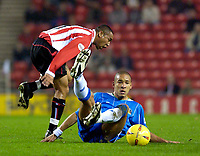 Photo. Jed Wee.<br /> Sunderland v Wigan Athletic, Nationwide League Division One, Stadium of Light, Sunderland. 02/12/03.<br /> Sunderland's Jeff Whitley (L) is foiled by an unconventional tackle from Wigan's Jason Jarett.