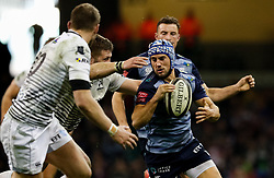 Cardiff Blues' Matthew Morgan under pressure from Ospreys' Scott Otten<br /> <br /> Photographer Simon King/Replay Images<br /> <br /> Guinness PRO14 Round 21 - Cardiff Blues v Ospreys - Saturday 28th April 2018 - Principality Stadium - Cardiff<br /> <br /> World Copyright © Replay Images . All rights reserved. info@replayimages.co.uk - http://replayimages.co.uk