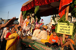 A festival procession proceeds down the street in Anand, India on April 14, 2007. Once famous as the milk capital of India, home to the country's most successful dairy farmer cooperative, the city is now known for Dr. Nayna Patel's controversial surrogacy program.