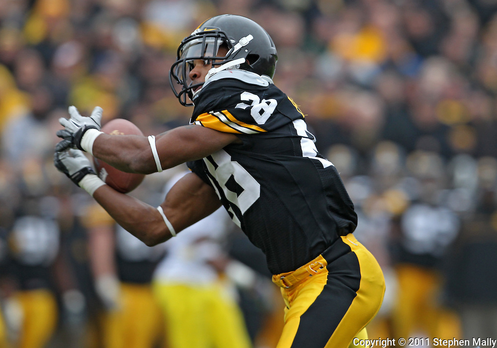 November 05, 2011: Iowa Hawkeyes defensive back Shaun Prater (28) stops a punt from going into the end zone during the second half of the NCAA football game between the Michigan Wolverines and the Iowa Hawkeyes at Kinnick Stadium in Iowa City, Iowa on Saturday, November 5, 2011. Iowa defeated Michigan 24-16.
