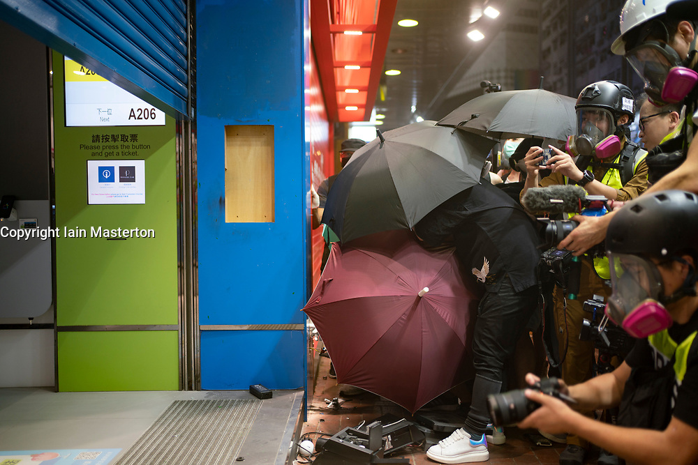 Hong Kong. 4 October 2019. Violent scenes in Hong Kong tonight with pro-democracy protestors vandalising shops and setting fire to the entrances of MTR stations. Protestors are angry with Chief Executive Carrie Lam's use of Emergency Powers to ban the wearing of masks during protests. Further demonstrations planned over the weekend. Pic; China Mobile phone shop broken into and damaged by protestors. Iain Masterton/Alamy Live News.