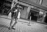 2012 May 08 - Man with headphones at Pike Place Market, Seattle. Copyright Richard Walker