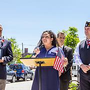 Assembly Member Nathalia Fernandez (speaking), AL Post #19 Commander Earl Menard, East Bronx History Forum President Richard Vitacco, and Al Post # 253 Second Vice Commander Gene DeFrancis