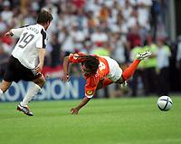 Fotball,  Portugal, EM, Euro 2004, 150604, Tyskland - Nederland<br /> Bernd Schneider, Tyskland og Edgar Davids, Nederland<br /> Photo:Digitalsport