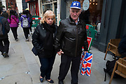 Tourist couple out and about with Union Jack Flag shopping bags in Covent Garden, London, England, United Kingdom. (photo by Mike Kemp/In Pictures via Getty Images)