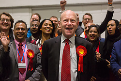 © Licensed to London News Pictures. 12/06/2015. London, UK. Labour's JOHN BIGGS (centre) with Labour party supporters at the Excel Centre in London celebrate after winning the Tower Hamlets Mayor election. Lutfur Rahman was removed from office for fraud and corrupt practices by an election court earlier this year and the 2014 election was rerun as a result. Photo credit : Vickie Flores/LNP