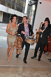 NANCY DELL'OLIO and musicians at a dinner in aid The Journalism Foundation held at Philips De Pury & Company, Howick Place, London, SW1 on 22nd May 2012.