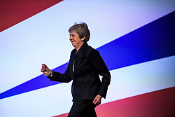 © Licensed to London News Pictures. 03/10/2018. Birmingham, UK. British Prime Minister THERESA MAY dances as she arrives on stage to deliver her Leaders speech on the fourth and final day of the 2018 Conservative Party conference at the ICC in Birmingham. This years event is focused heavily on Brexit and negotiations with the EU over the UK's exit form the European Union. Photo credit: Ben Cawthra/LNP