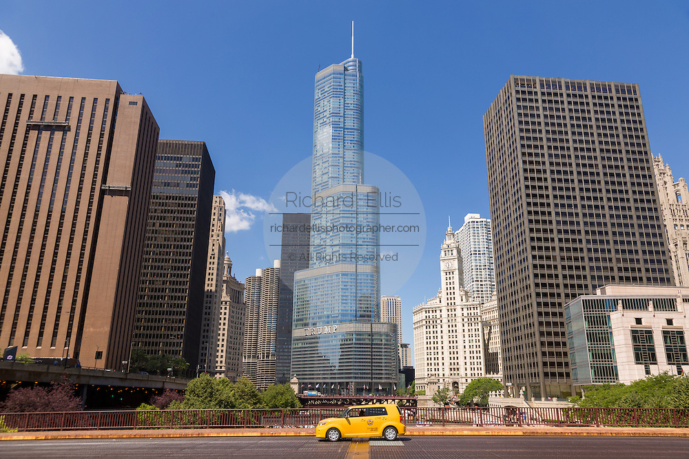 Wrigley Building and Trump Tower and yellow taxi from the Irv Kupcinet Bridge on a summers day in Chicago, Illinois, USA
