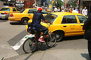 New York, New York. United States. June 9th 2004.Corner 6th Avenue and 56th Street