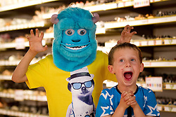 © Licensed to London News Pictures. 27/06/2013. London, UK. Jonah, 6, is seen scaring Jonah, 6, with a 'Sulley Monster Mask' (Hamleys price GB£40) at the Christmas in June press event at Hamleys toy shop in London today (27/06/2013).  Held in retailers world famous Regents Street store, the event showcases the predicted top toys for Christmas 2013. Photo credit: Matt Cetti-Roberts/LNP