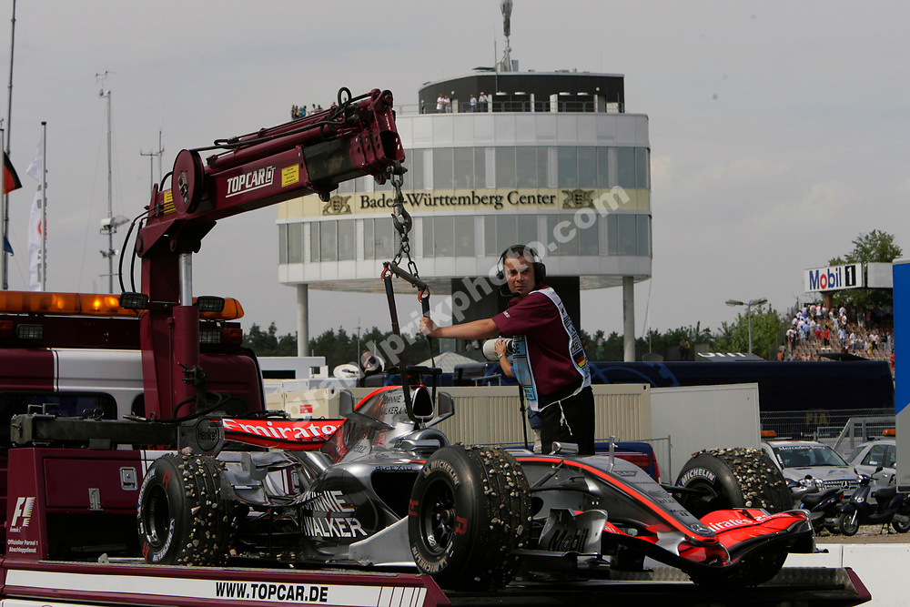 The McLaren-Mercedes of Pedro de la Rosa is brought back to the the pits after its retirement in the 2006 German Grand Prix at Hockenheim. Photo: Grand Prix Photo