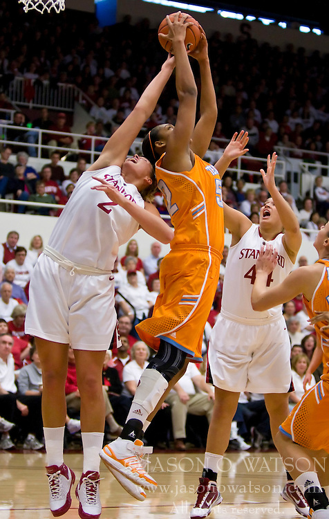 December 19, 2009; Stanford, CA, USA;  Tennessee Lady Volunteers center Kelley Cain (52) grabs a rebound from Stanford Cardinal forward/center Jayne Appel (2) during the first half at Maples Pavilion.  Stanford defeated Tennessee 67-52.
